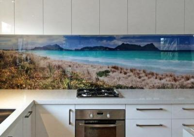 A beach scape digitally printed glass splashback