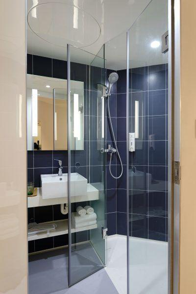 clean bathroom and well maintained glass shower screens