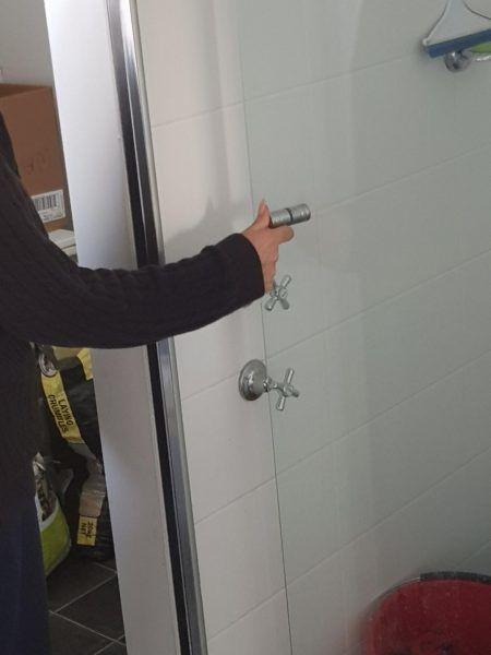 shower screen design fail with door hinge opening the wrong way