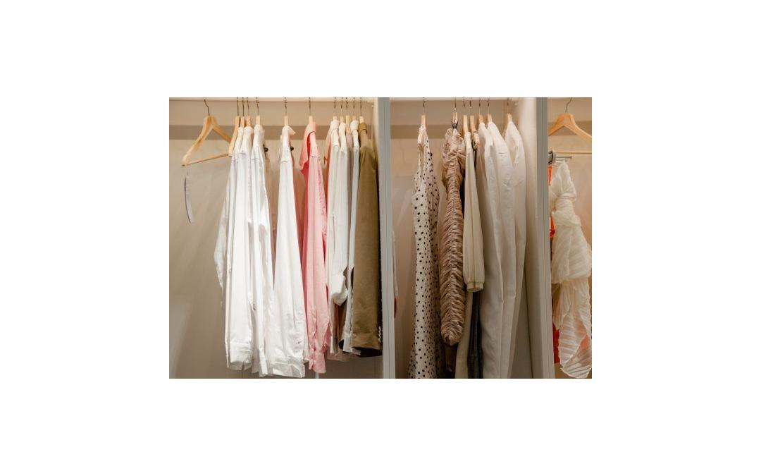 wardrobe with hanging clothes